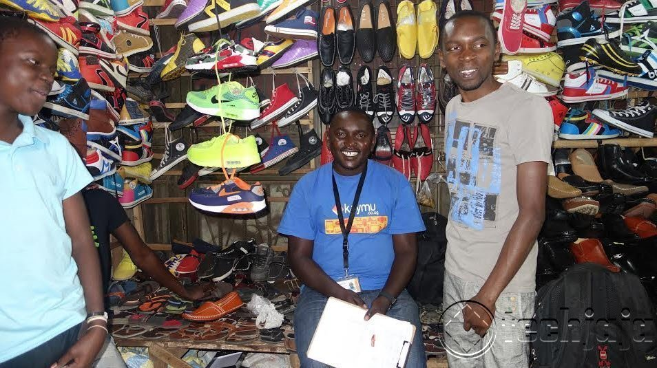 John Baptist Kaymu Delivery Specialist, picking up orders from seller