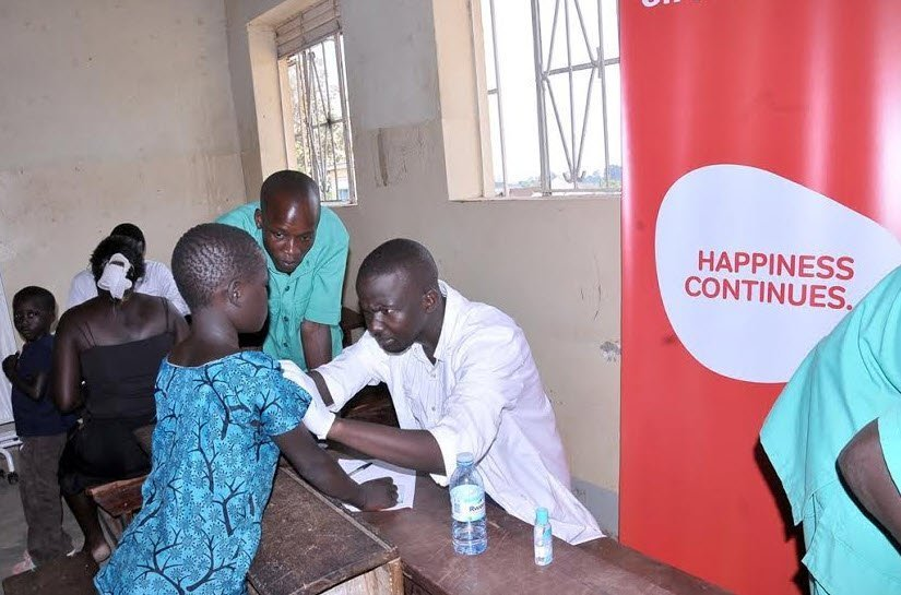 A doctor attends to a child during the airtel community health fair in Arua