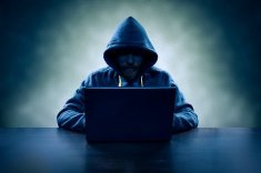 stock-photo-71677841-computer-hacker-stealing-information-with-laptop